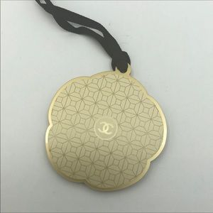 CHANEL Gold plastic logo charm Iconic Collectable